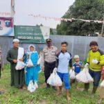 Polres Kutim Bagikan 1300 Bingkisan Daging Kurban ke Pondok Pesantren dan Warga
