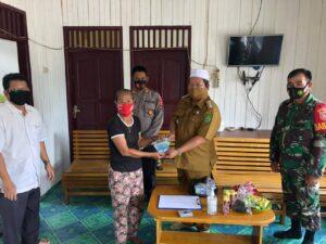 Kapolsek Muara Wahau Hadiri Penyaluran BLT-DD Desa Jak Luay