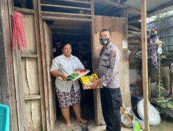 Peduli Masyarakat Ditengah PPKM Yang Diperketat, Polres Kutim Bagikan Paket Sembako