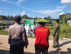Kapolsek Muara Ancalong Pimpin Pengamanan Pemakaman Jenazah Pasien Covid-19